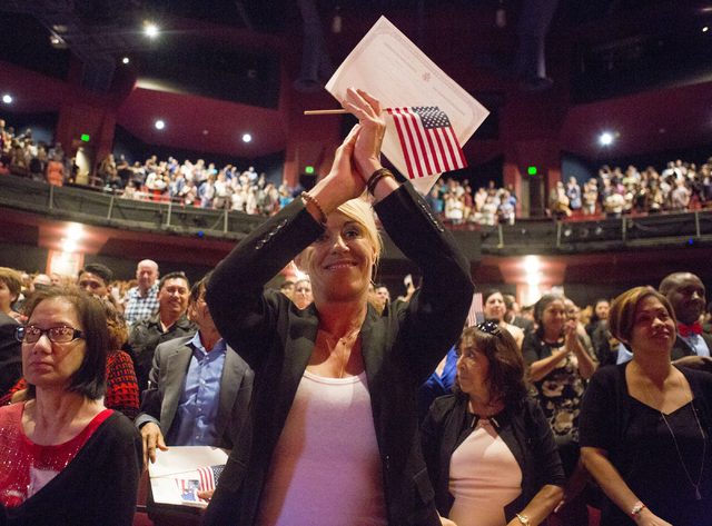 Isabelle Florence Gofourth, originally from France, claps her hands during a naturalization ceremony at Cashman Field, Thursday, Sept. 22, 2016, in Las Vegas. (Elizabeth Page Brumley/Las Vegas Rev ...