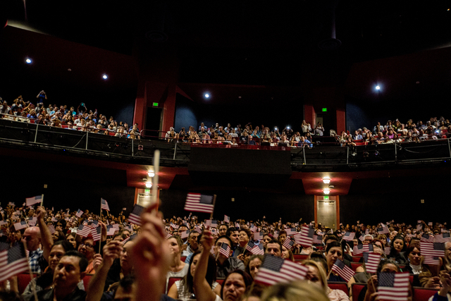 New United States citizens wave flags during a naturalization ceremony at Cashman Field, Thursday, Sept. 22, 2016, in Las Vegas. (Elizabeth Page Brumley/Las Vegas Review-Journal) Follow @ELIPAGEPHOTO