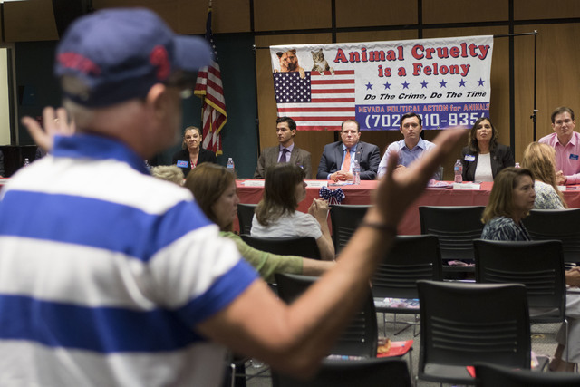"Las Vegas resident Michael Follen makes a comment during the event, ""Animal Friendly Candidate Meet & Greet,"" hosted by the Nevada Political Action for Animal at the Rainbow  ..."