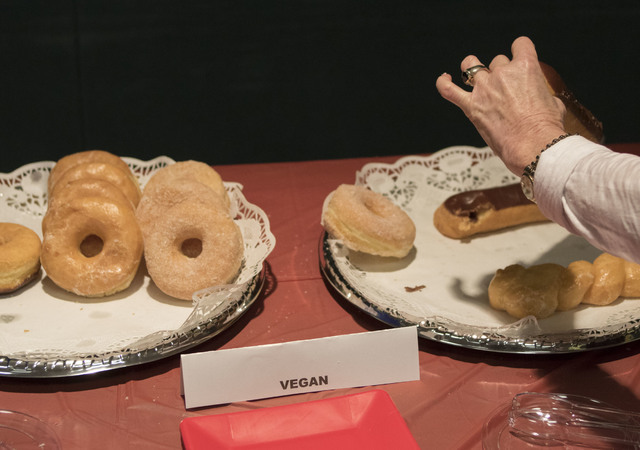 "A woman picks up a vegan donut during the event, ""Animal Friendly Candidate Meet & Greet,"" hosted by the Nevada Political Action for Animal at the Rainbow Library in Las Vega ..."