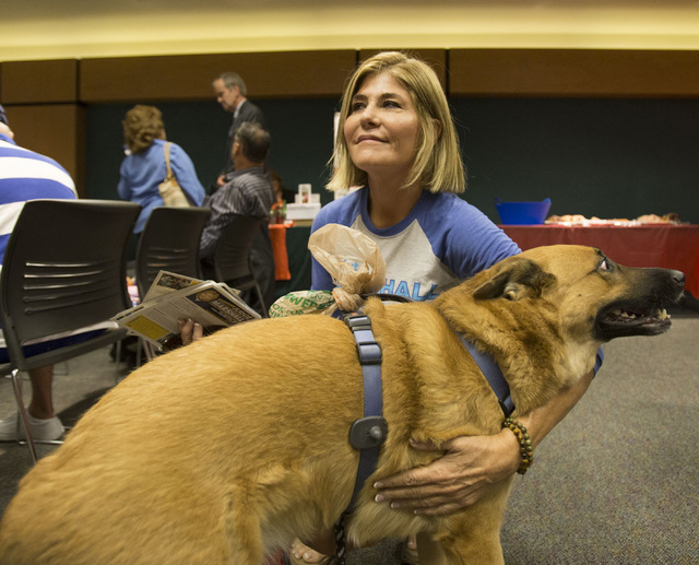 "Judge Janiece Marshall pets her dog Butter during the event, ""Animal Friendly Candidate Meet & Greet,"" hosted by the Nevada Political Action for Animal at the Rainbow Library ..."