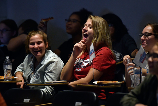 Desert Oasis High School student Kaitlyn Willoughby chuckles as she watches the presidential debate during an event at UNLV Monday, Sept. 26, 2016, in Las Vegas. Several hundred college, middle an ...
