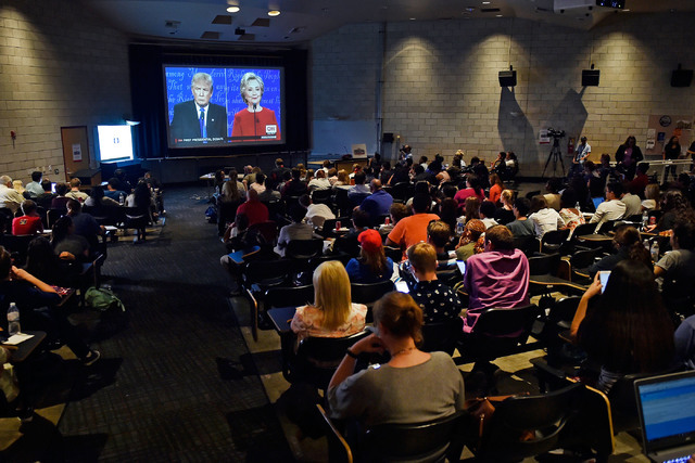 Student watch the presidential debate during an event at UNLV Monday, Sept. 26, 2016, in Las Vegas. Several hundred college, middle and high school debate students watched the first presidential d ...
