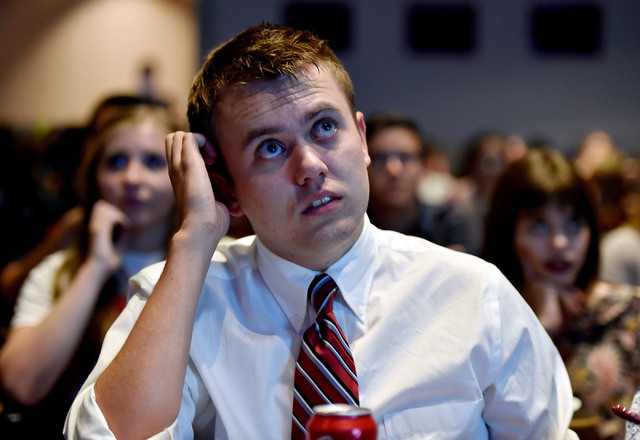 UNLV student Matthew Gomez watches the presidential debate during an event at UNLV Monday, Sept. 26, 2016, in Las Vegas. Several hundred college, middle and high school debate students watched the ...