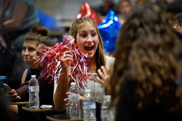 Palo Verde High School student Makena Martin uses a pom pom before a presidential debate watch party at UNLV Monday, Sept. 26, 2016, in Las Vegas. Several hundred college, middle and high school d ...