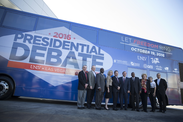 The Board of Directors for the Las Vegas Convention and Visitors Authority stand outside of the Las Vegas Convention Center Board Room following a public hearing on the UNLV Presidential Debate on ...