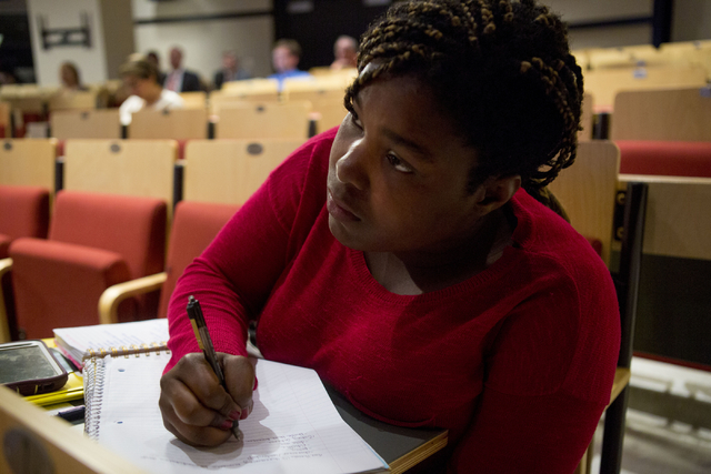 Camille Morris, UNLV Junior, studying Communication Studies, takes notes while Edward Hinck, professor at the College of Communication & Fine Arts at Central Michigan University, talks about p ...