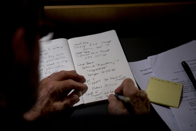 A student takes notes while Edward Hinck, professor at the College of Communication & Fine Arts at Central Michigan University, talks about politeness in presidential debates at the UNLV Presi ...