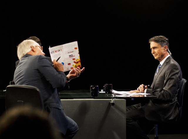 Pat Hickey, with Nevadans for Responsible Drug Policy, points to an information pamphlet during a Vegas Public Broadcasting Service roundtable discussion regarding the Nevada Marijuana Legalizatio ...