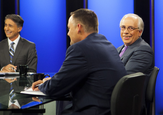 "Moderator and former ""Nevada Week in Review"" host Mitch Fox, left, Todd Raybuck, executive lieutenant at the Las Vegas Metropolitan Police Department, center, and Pat Hickey, with Nevadans for Res ..."