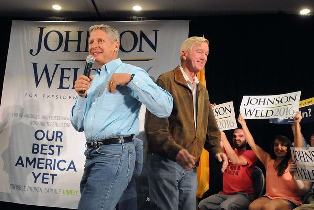 Libertarian presidential candidate and former New Mexico Gov. Gary Johnson. left, takes the stage at the Albuquerque Convention Center after being introduced by his running mate Bill Weld during a ...