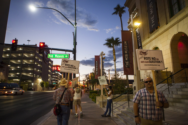 People rally outside of the Mob Museum ahead of a town hall discussion on Question 1 in Las Vegas on Thursday, Sept. 29, 2016. Question 1 is the Nevada State ballot initiative to expand firearm ba ...