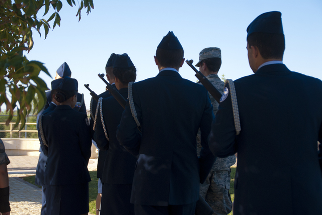 Members of the Palo Verde High School Air Force JROTC prepare to honor the victims of the 9/11 attacks with a flag rededication ceremony at the Barbara Edwards Memorial on campus in Las Vegas on F ...