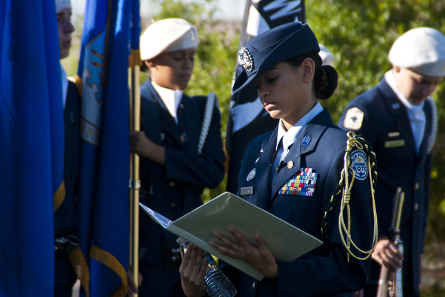 Victoria Furutani, of the Palo Verde High School Air Force JROTC, prepares to honor the victims of the 9/11 attacks with a flag rededication ceremony at the Barbara Edwards Memorial on the Palo Ve ...
