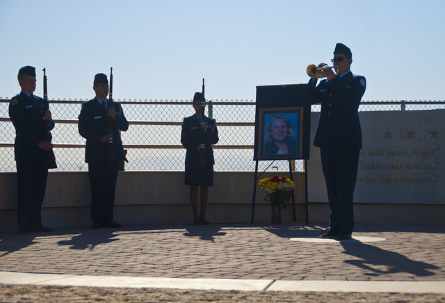 Zack Severance of the Palo Verde High School Air Force JROTC, right, honors the victims of the 9/11 attacks at a flag rededication ceremony at the Barbara Edwards Memorial on the Palo Verde campus ...