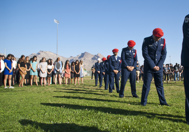Members of the Palo Verde High School Air Force JROTC  honor the victims of the 9/11 attacks with a flag rededication ceremony at the Barbara Edwards Memorial on campus in Las Vegas on Friday, Sep ...