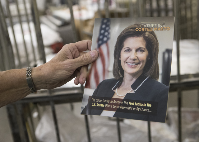 Kathy Gillespie, owner of A&B Printing and Mailing holds up a political advertisement that was printed at the facility on Thursday, Sept. 22, 2016, in Las Vegas. Loren Townsley/Las Vegas Revie ...