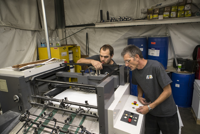 Eric Christ, left, and David Welcher examines a printing machine at the A&B Printing and Mailing headquarters on Thursday, Sept. 22, 2016, in Las Vegas. Loren Townsley/Las Vegas Review-Journal ...