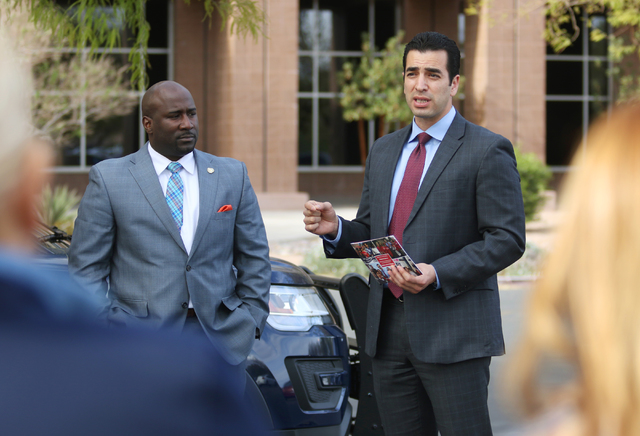 Democratic state Senator Ruben Kihuen, right, speaks to supporters with Councilman Ricki Barlow prior to filing with the Secretary of State's office for the Congressional District 4 race Monday, M ...