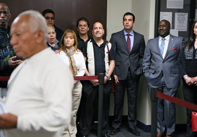 Democratic state Sen. Ruben Kihuen, third from right, stands with Las Vegas City Councilman Ricki Barlow, second from right, as the senator waits to file with the Secretary of State's office for t ...