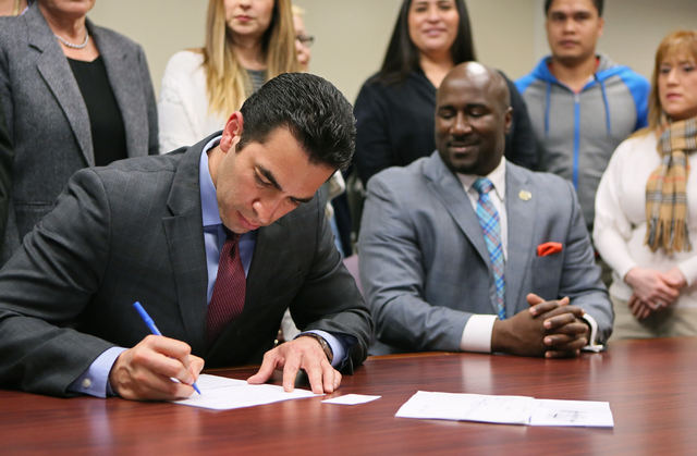 Democratic state Sen. Ruben Kihuen, left, fills out paperwork to file with the Secretary of State's office for the 4th Congressional District race Monday, March 7, 2016, in Las Vegas. Councilman R ...