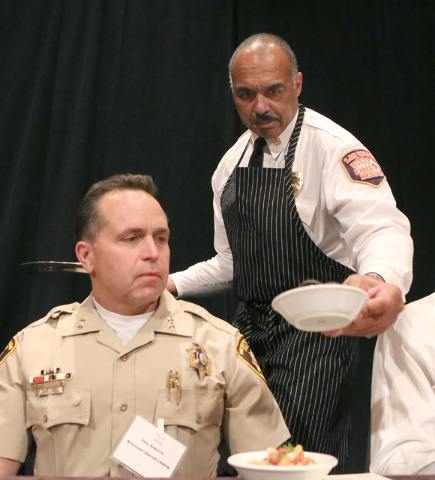 Las Vegas Fire Chief Willie McDonald, right, serves Assistant Sheriff Tom Roberts, to taste the food he made during the third annual Emergency Preparedness Kit Cook-Off competition on Thursday, Se ...