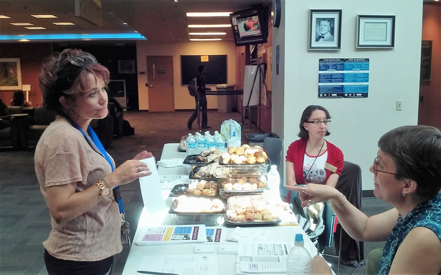 ASCN-Student Government Sen. Shannon Laviguer, left, contemplates Women's Equality Day and other issues with Sondra Cosgrove, CSN professor of history, right, while Stephanie Espinoza, CSN E-lea ...