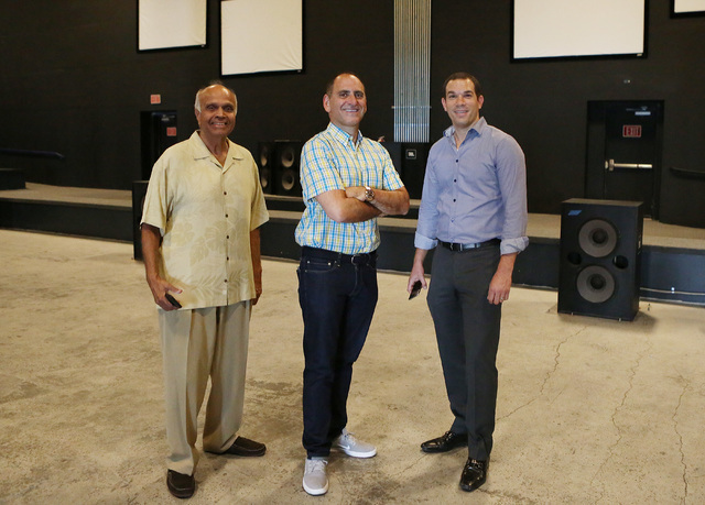 Rohit Joshi, left, Alex Igelman, CEO of Millennial Esports and Ofir Ventura pose for a photo inside Neonopolis' movie theater on Thursday, Sep. 1, 2016, in Las Vegas. (Bizuayehu Tesfaye/Las Vegas  ...
