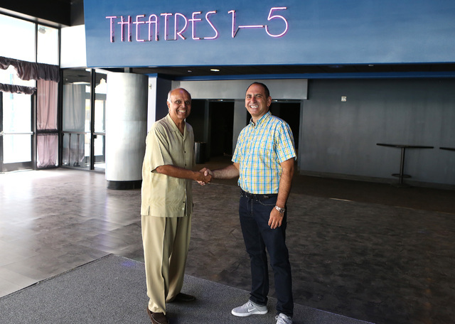 Rohit Joshi, left, shake hands with Alex Igelman, CEO of Millennial Esports inside Neonopolis' movie theater on Thursday, Sep. 1, 2016, in Las Vegas. (Bizuayehu Tesfaye/Las Vegas Review-Journal Fo ...