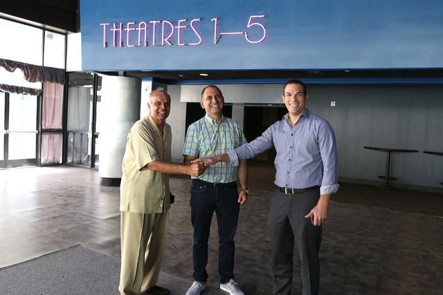 Rohit Joshi, left, Alex Igelman, CEO of Millennial Esports and Las vegas attorney Ofir Ventura pose for a photo inside Neonopolis' movie theateron Thursday, Sep. 1, 2016, in Las Vegas. (Bizuayehu  ...