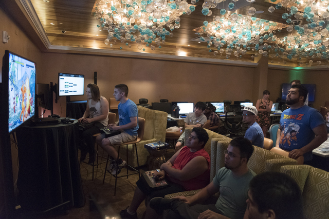 Ashton Beliveau, left, and Steven Linakis, second from left,  compete in the Street Fighter V tournament at the Downtown Underground e-sports lounge at Downtown Grand hotel-casino in Las Vegas on  ...