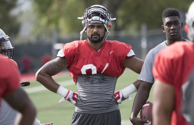UNLV defensive end Jeremiah Valoaga stands on the field while on a scrimmage during team practice at the Bill 'Wildcat' Morris Rebel Park field on Tuesday, Sept. 20, 2016. (Richard Brian/Las Vegas ...