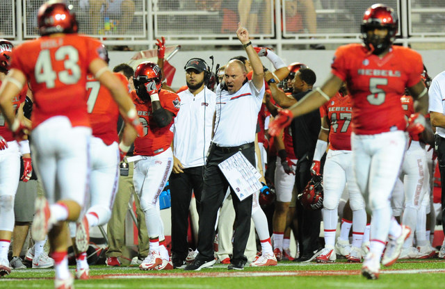 UNLV head coach Tony Sanchez, center, celebrates a touchdown against Jackson State in the first half of their NCAA college football game at Sam Boyd Stadium in Henderson Wednesday Sept. 1, 2016. J ...