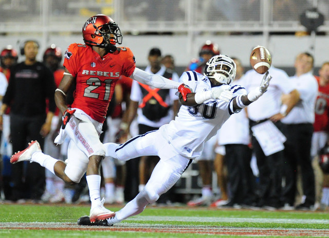 Jackson State wide receiver Will Golston (80) is unable to make a catch while UNLV defensive back Darius Mouton (21) defends in the first half of their NCAA college football game at Sam Boyd Stadi ...