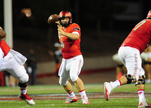 UNLV quarterback Johnny Stanton throws a touchdown pass against Jackson State in the first half of their NCAA college football game at Sam Boyd Stadium in Henderson Wednesday Sept. 1, 2016. Josh H ...