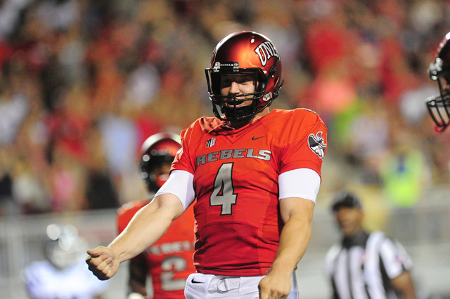 UNLV quarterback Johnny Stanton reacts after throwing a touchdown pass against Jackson State in the first half of their NCAA college football game at Sam Boyd Stadium in Henderson Wednesday Sept.  ...