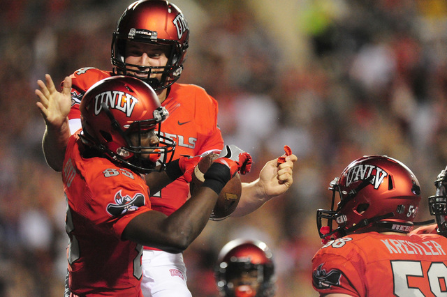 UNLV quarterback Johnny Stanton celebrates with wide receiver Devonte Boyd (83) after throwing a touchdown pass against Jackson State in the first half of their NCAA college football game at Sam B ...