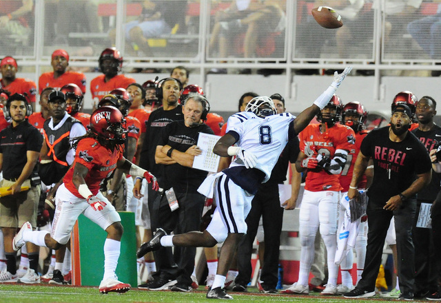 Jackson State wide receiver Robert Porter (8) is unable to catch an overthrown pass while UNLV  defensive back Jay'Onn Myles (1) defends in the first half of their NCAA college football game at Sa ...