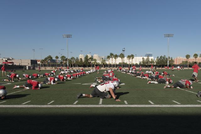 Players stretch during football practice at UNLV's Rebel Park in Las Vegas, Tuesday, Sept. 27, 2016. (Jason Ogulnik/Las Vegas Review-Journal)