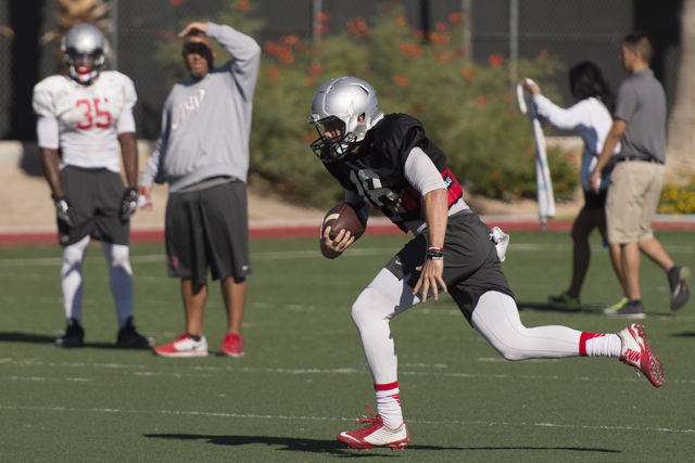 Dalton Sneed (18) runs will the football during practice at UNLV's Rebel Park in Las Vegas, Tuesday, Sept. 27, 2016. (Jason Ogulnik/Las Vegas Review-Journal)