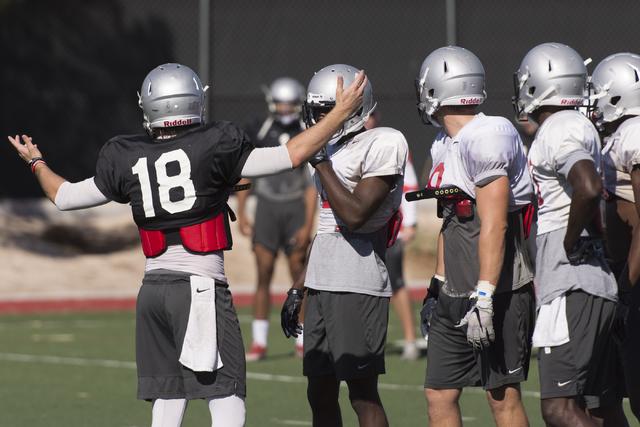 Dalton Sneed (18) talks with teammates during football practice at UNLV's Rebel Park in Las Vegas, Tuesday, Sept. 27, 2016. (Jason Ogulnik/Las Vegas Review-Journal)
