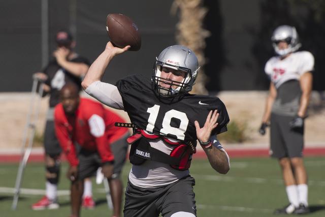 Dalton Sneed (18) throws the football during practice at UNLV's Rebel Park in Las Vegas, Tuesday, Sept. 27, 2016. (Jason Ogulnik/Las Vegas Review-Journal)