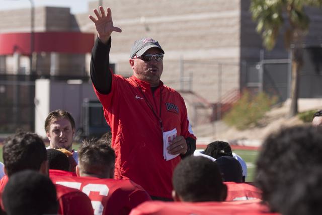 Head coach Tony Sanchez speaks with players during football practice at UNLV's Rebel Park in Las Vegas, Tuesday, Sept. 27, 2016. (Jason Ogulnik/Las Vegas Review-Journal)