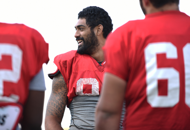 Defensive end Jeremiah Valoaga (94) smiles with teammates during football practice at Rebel Park inside the UNLV campus in Las Vegas on Thursday, Aug. 25, 2016. (Martin S. Fuentes/Las Vegas Review ...