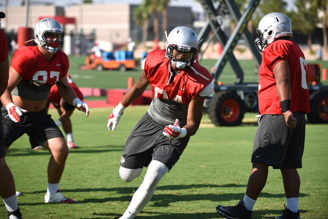 Defensive end Jeremiah Valoaga (94) runs a play during football practice at Rebel Park inside the UNLV campus in Las Vegas on Thursday, Aug. 25, 2016. (Martin S. Fuentes/Las Vegas Review-Journal)