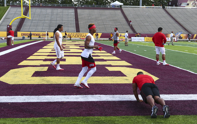 UNLV players warm up on the field before playing against Central Michigan in a football game at Kelly/Shorts Stadium in Mount Pleasant, Mich. on Saturday, Sept. 17, 2016. Chase Stevens/Las Vegas R ...