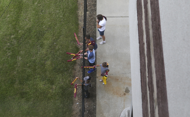Young football fans watch high school marching bands pass by before a game against UNLV at Kelly/Shorts Stadium in Mount Pleasant, Mich. on Saturday, Sept. 17, 2016. Chase Stevens/Las Vegas Review ...