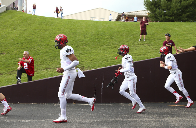 UNLV fan Dan Geimer, who drove 2,000 miles from Henderson, left, cheers on football players before they play against Central Michigan at Kelly/Shorts Stadium in Mount Pleasant, Mich. on Saturday,  ...