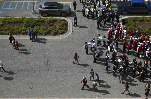 Football fans and members of high school marching bands pass by before a game against UNLV at Kelly/Shorts Stadium in Mount Pleasant, Mich. on Saturday, Sept. 17, 2016. Chase Stevens/Las Vegas Rev ...