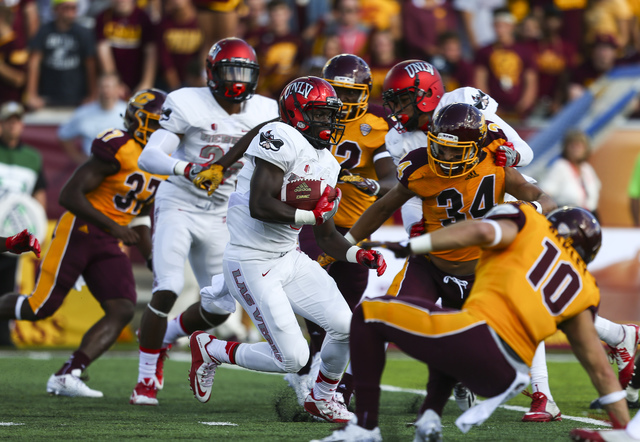 UNLV running back Charles Williams (8) runs the ball against Central Michigan during a football game at Kelly/Shorts Stadium in Mount Pleasant, Mich. on Saturday, Sept. 17, 2016. Chase Stevens/Las ...